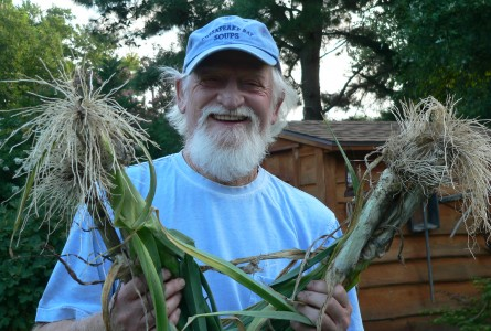 Whitey Schmidt shows off leeks from his garden.