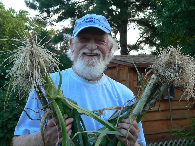 Whitey Schmidt shows off leeks from his garden.